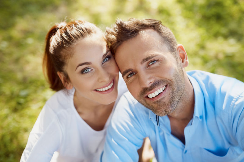 couple smiling after teeth whitening