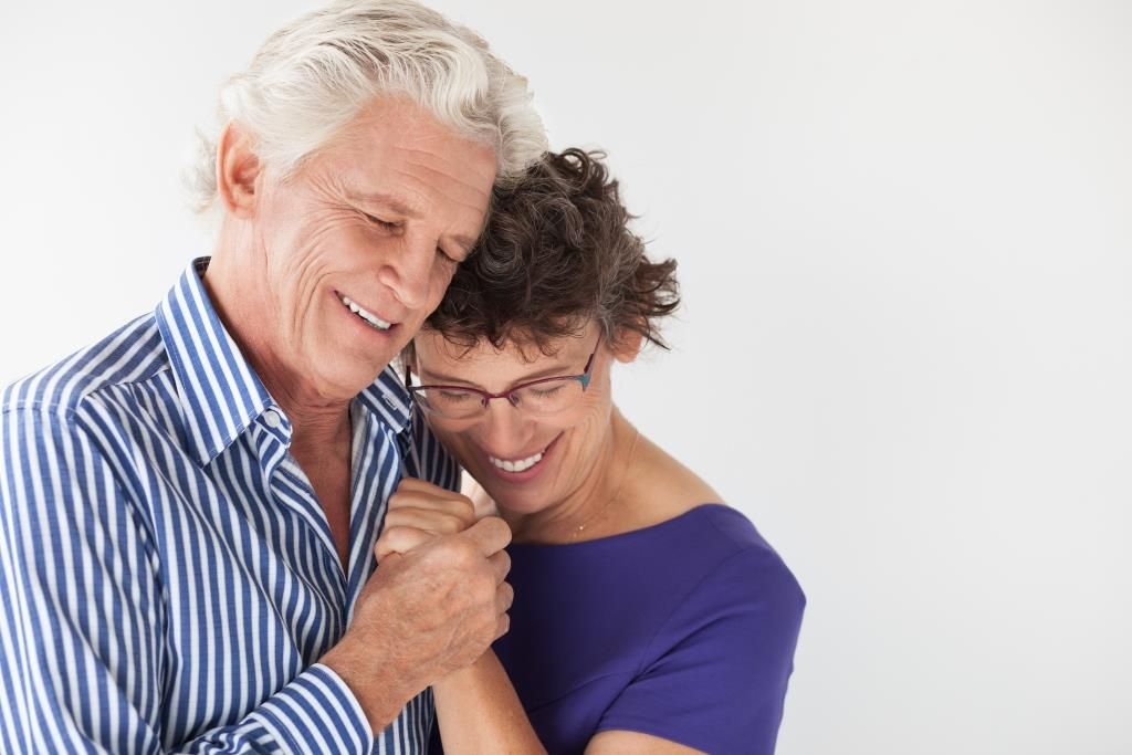 dental implant dentist | Happy elderly couple.