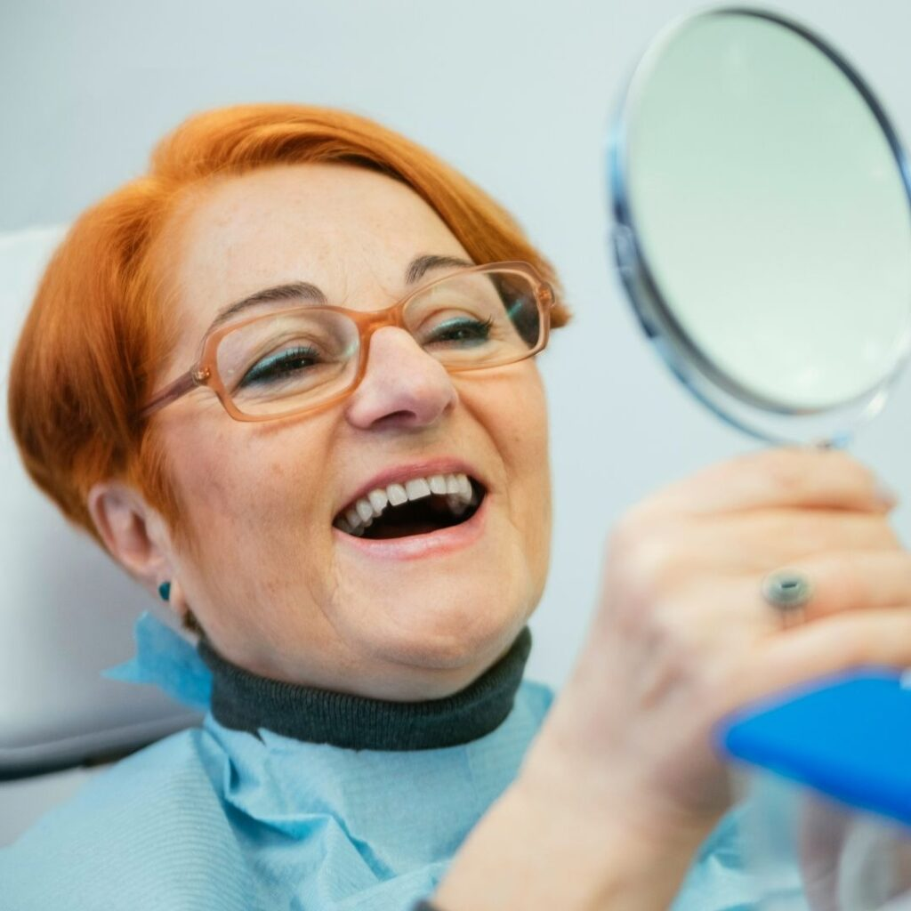 woman with dental implants | dental implants near me